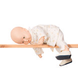 Baby doll on a crossbar Stock Photography