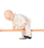 Baby doll on a crossbar Royalty Free Stock Photos