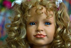 Curly baby doll face. Baby doll head Stock Photo