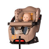 Baby Doll In A Booster Seat For A Car Stock Images
