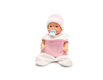 Baby doll in pink clothes isolated on white background Stock Photo