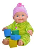 Baby doll playing with cubes Royalty Free Stock Image