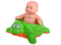 Baby Doll sitting on turtle Stock Photo