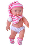 Baby Doll toy in nightcap Stock Image