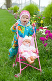 Baby with doll on walk. Royalty Free Stock Photos