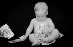 Baby and dollars. Baby boy and dollars portrait - black and white Stock Image