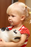 Baby and donkey. She is cute baby and donkey Stock Photography