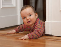 Baby in the door Stock Photos