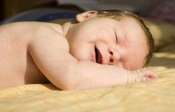 Baby door de slaap Royalty-vrije Stock Afbeeldingen