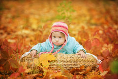 Baby with Down syndrome is resting in autumn forest Royalty Free Stock Photos
