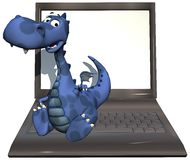 Baby dragon blue on laptop Royalty Free Stock Photos