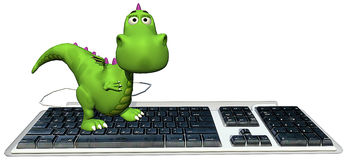 Baby dragon green on keyboard happy Royalty Free Stock Images