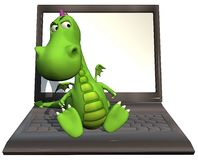 Baby dragon green on laptop Stock Photos