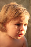 Baby with dramatic sunlight Stock Photography