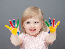 Baby is drawing. Paint. Grey background Stock Photos