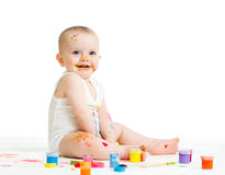 Baby drawing with a finger's paints Royalty Free Stock Image