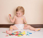 Baby drawing with her fingers. Toddler painting. Stock Photos