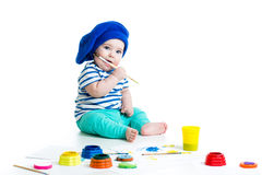 Baby drawing with paints. Cute child drawing with paints royalty free stock photo