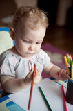 Baby drawing with pencils Royalty Free Stock Images