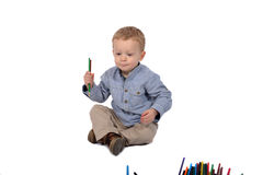 Baby draws with crayons Stock Photography