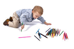 Baby draws with crayons Royalty Free Stock Images