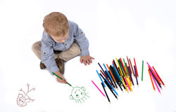 Baby draws with crayons Stock Image