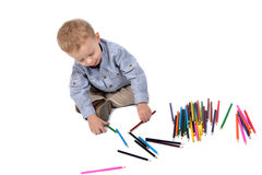 Baby draws with crayons Stock Photo