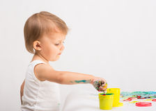Baby draws a finger paints Royalty Free Stock Image