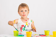 Baby draws a finger paints Stock Photography