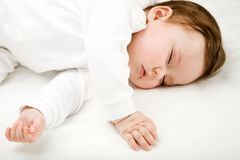 Baby dreaming. Photo of a baby, sleeping, isolated on white Royalty Free Stock Image