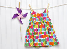 Free Baby Dress And Pinwheel On A Clothesline Stock Image - 24172361