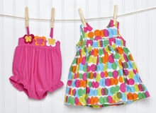 Baby Dress and Bathing Suit on a Clothesline Royalty Free Stock Photography