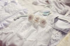 Baby dress and bonnet. Beautiful white dress and bonnet for a newborn baby Royalty Free Stock Image