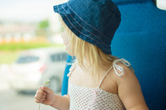 Baby in dress and hat with flower ride bus Royalty Free Stock Photography