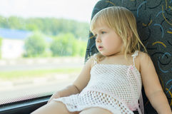 Baby in dress ride bus Stock Image