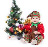 A baby dressed as a. Elf.  isolated Royalty Free Stock Photos