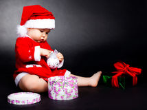 Baby dressed as Santa Stock Images