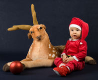 The baby is dressed as Santa Claus and reindeer Royalty Free Stock Photography