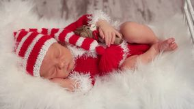 Baby dressed as Santa with a toy stock footage