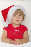 Baby dressed as Santa under the falling snow Royalty Free Stock Photo