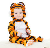 Baby dressed as a tiger Stock Image