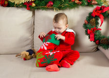 Baby dressed in a Christmas costume Stock Image