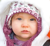 Baby dressed for cold weather. royalty free stock photo