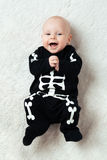 Baby dressed skeleton Stock Photography