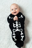 Baby dressed skeleton. Little baby dressed funny skeleton Stock Photography
