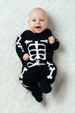Baby dressed skeleton. Little baby dressed funny skeleton Stock Photos