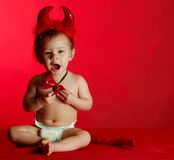 Baby dressed up like a devil Stock Photography