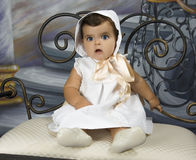 Baby dressed in vintage clothing. Is a baby dressed in vintage clothing Stock Image