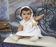 Baby dressed in vintage clothing Stock Image