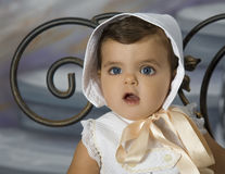 Baby dressed in vintage clothing. Is a baby dressed in vintage clothing stock photography